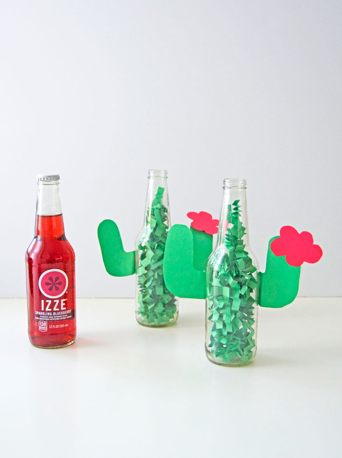 DIY one schnazzy centerpiece for your Cinco de Mayo party! Just grab an empty IZZE bottle, construction paper, scissors and tape. | dcgirlinpearls.com